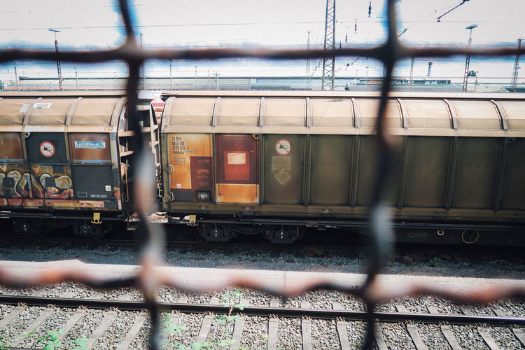Blurred Motion Day Fence Focus On Background Freight Train Land Vehicle Metal Mode Of Transportation Motion Nature No People Outdoors Public Transportation Rail Transportation Railroad Track Shunting Yard Track Train Train - Vehicle Transportation Travel