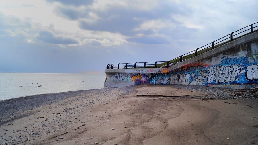 Multi Colored Spray Paint Sea Sky No People Outdoors Day Beach Scenics Graffiti Art Toronto Urban Art