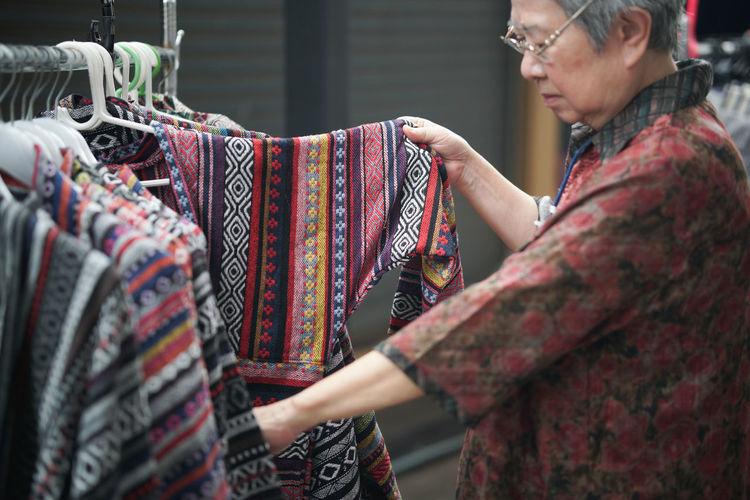 Woman choosing dress in store