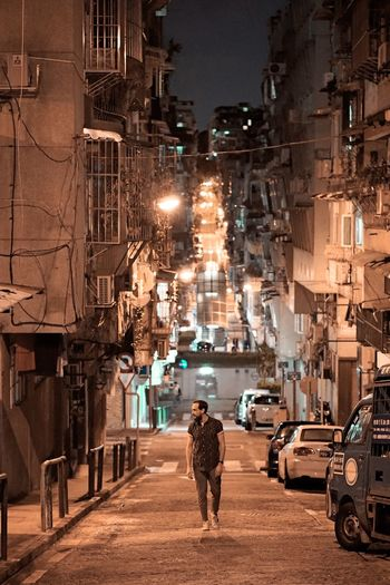 City Transportation Mode Of Transportation Street Architecture Car Motor Vehicle Women Building Exterior City Life Men Walking Rear View Illuminated Road People Real People Built Structure Night Adult