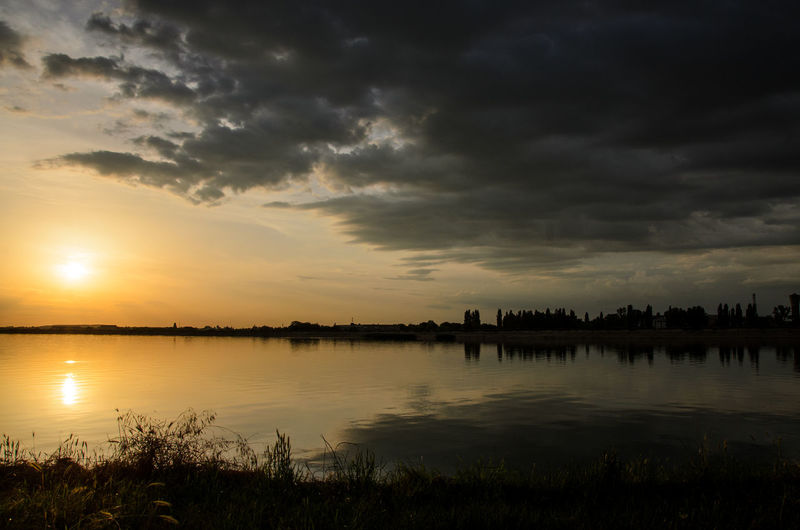 Calm Clouds Half Lake Nature Outdoors Reflection Sky Standing Water Sun Sunset Water