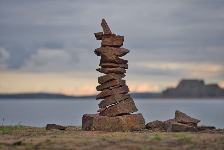 Stack of stones, an achievement of its own. Stack Water Balance Rock Focus On Foreground Stack Rock Cloud - Sky No People Zen Meditation Most Popular Exceptional Photographs Achievement Stones Creative Landmark Milestone Competition Best  Nature Rise Perfect Sea Rock - Object Stone - Object