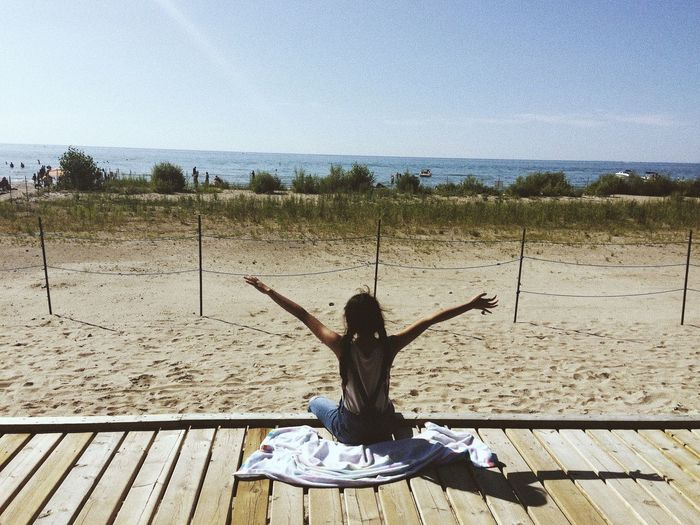 Beach View Wasaga Beach Beach One Person Real People Human Arm Leisure Activity Lifestyles Sunlight Women Arms Outstretched Sitting Day Casual Clothing Outdoors Sky Rear View Nature Arms Raised First Eyeem Photo