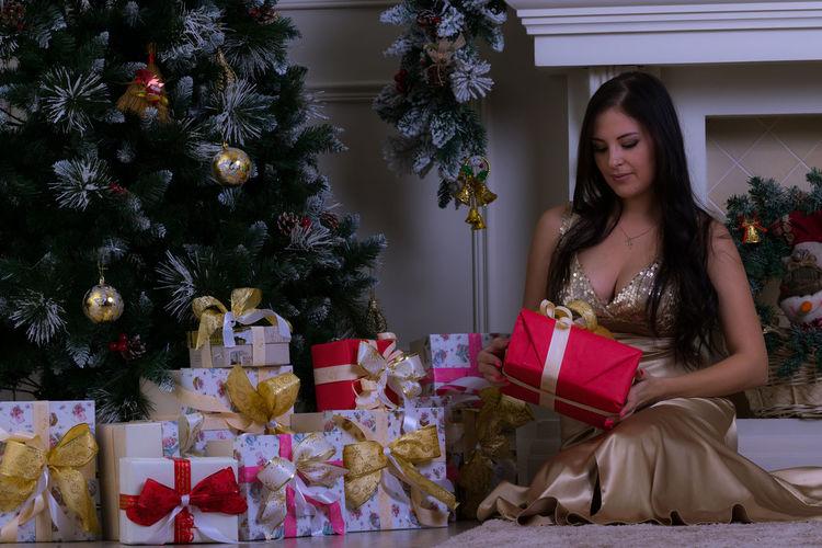 Beautiful woman holding christmas presents