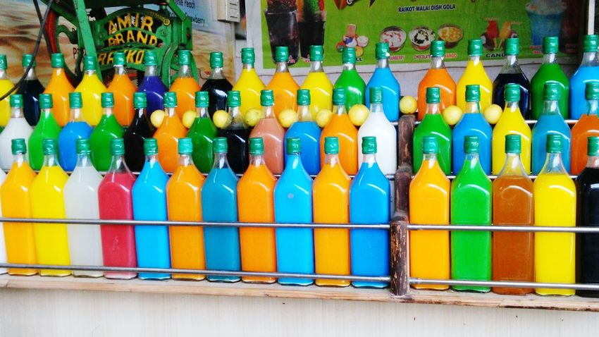 Multi Colored Bottle No People Large Group Of Objects Outdoors Road Side Traditional Drink No Alchohol Art Is Everywhere