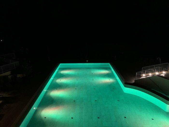 High angle view of illuminated swimming pool at night