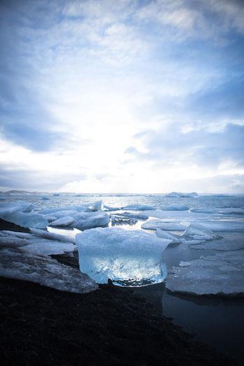 Glaciers On Jokulsarlon Lake Against Cloudy Sky