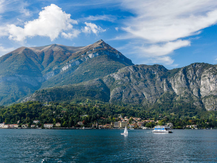 Mountains by lake como against cloudy sky