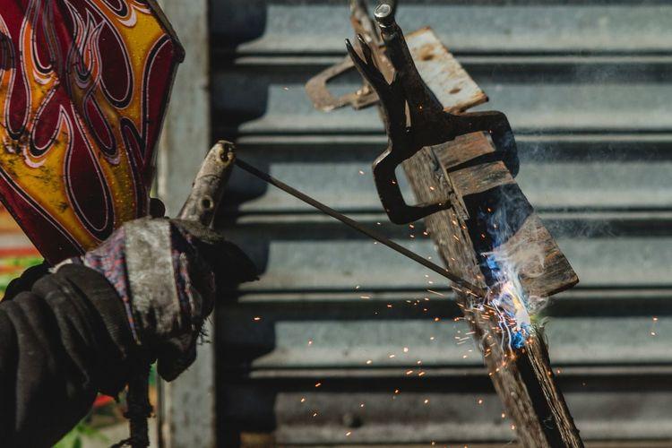 Welder Welding Metal Object