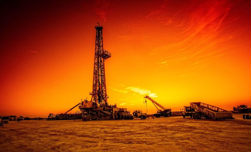 Looking for black gold Sunset Orange Color Sky No People Built Structure Drilling Rig Industry Oil Industry Fuel And Power Generation Architecture Nature Crane - Construction Machinery Tall - High Machinery Technology Tower Outdoors Offshore Platform Silhouette The Architect - 2018 EyeEm Awards The Photojournalist - 2018 EyeEm Awards