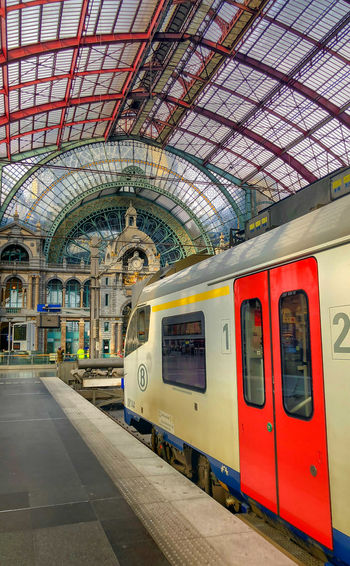 Antwerp, Belgium - Anno 2019: The train is waiting at the platform for passengers Inside the beautiful, historic and monumental Antwerp Train Station. Antwerp Central is often considered to be one of the most beautiful railway stations in the world. Rail Transportation Public Transportation Mode Of Transportation Transportation Train Train - Vehicle Railroad Station Platform Indoors  Railroad Station Track Architecture Passenger Train Railroad Track Travel Arch No People Ceiling Built Structure Day Subway Train Station Arrival Leaving