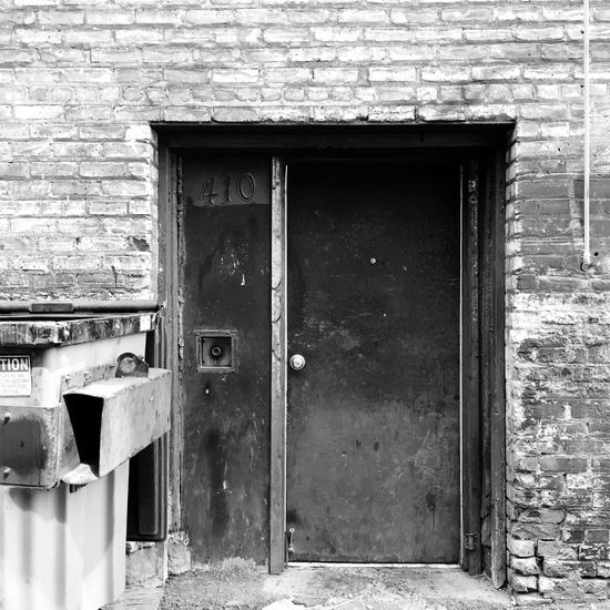 Architecture Built Structure Building Exterior Door Closed House Old Weathered Deterioration Entrance Day Damaged Outdoors Exterior No People Minnesota Photographer Alley Alleyway Streetphotography Urbanphotography Minnesotaphotographer Black And White Collection