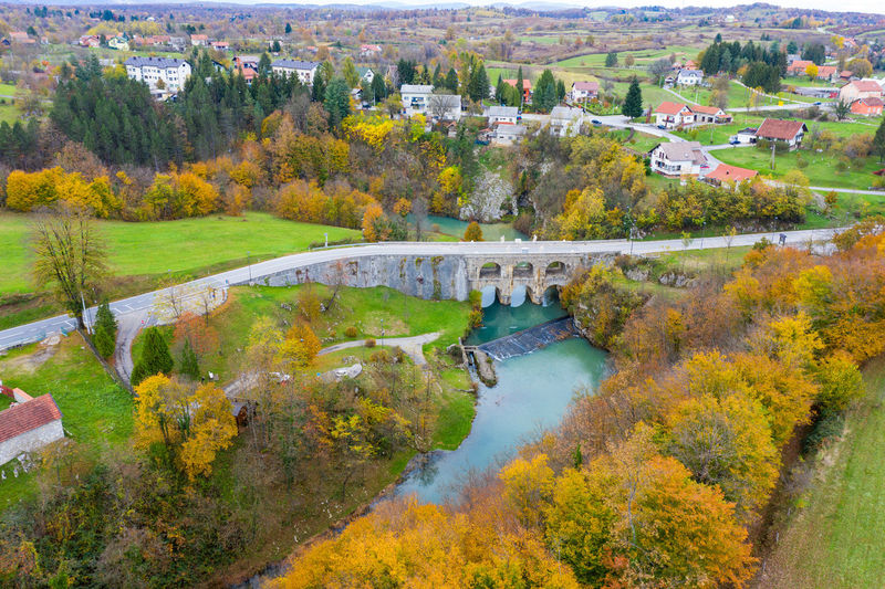 High angle view of arch bridge over river during autumn