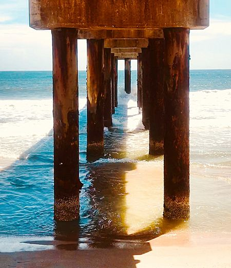 Wooden pier on sea shore
