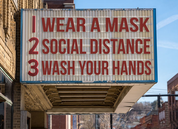 Warning sign on city