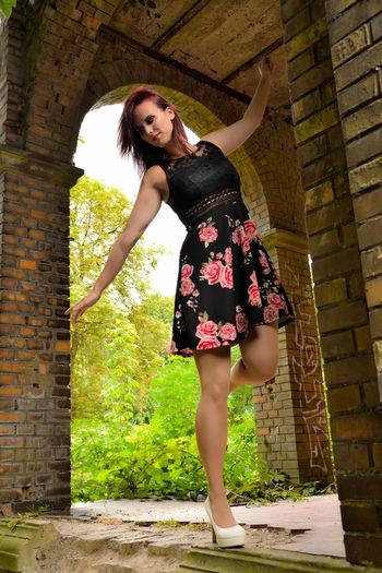 Beautiful woman standing in old ruin