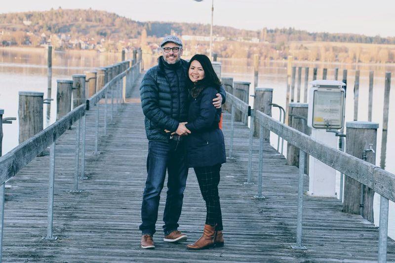Full Length Of Couple Standing On Pier