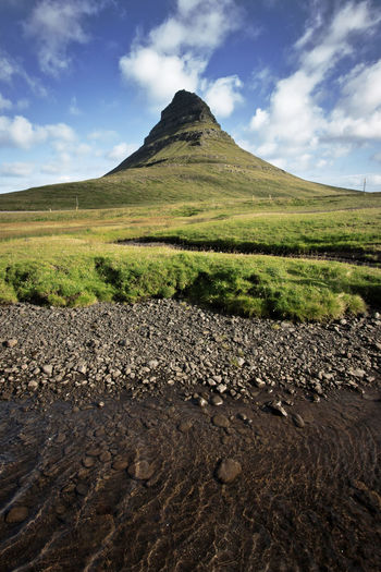 Beauty In Nature Cloud - Sky Day Green Color Hill Iceland Island Landscape Mountain Natural Disaster Nature No People Outdoors Scenics Sky Tranquil Scene Tranquility
