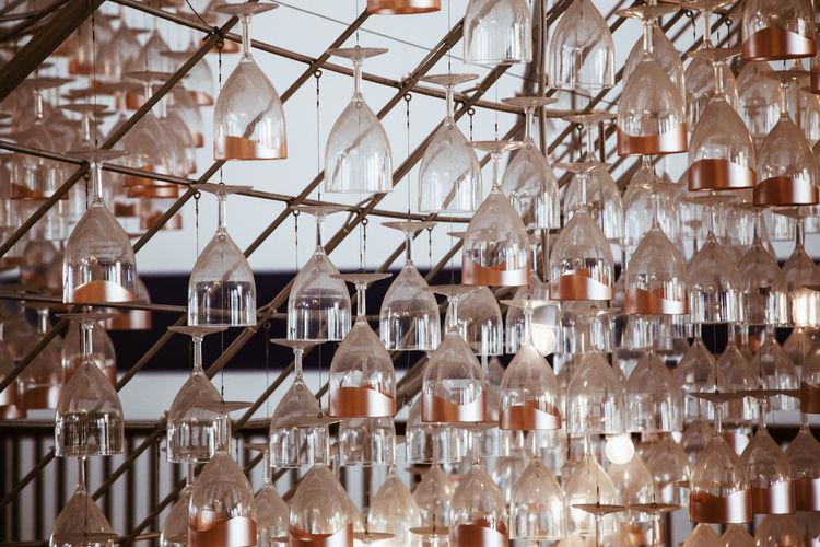 Wineglasses hanging on rack in bar