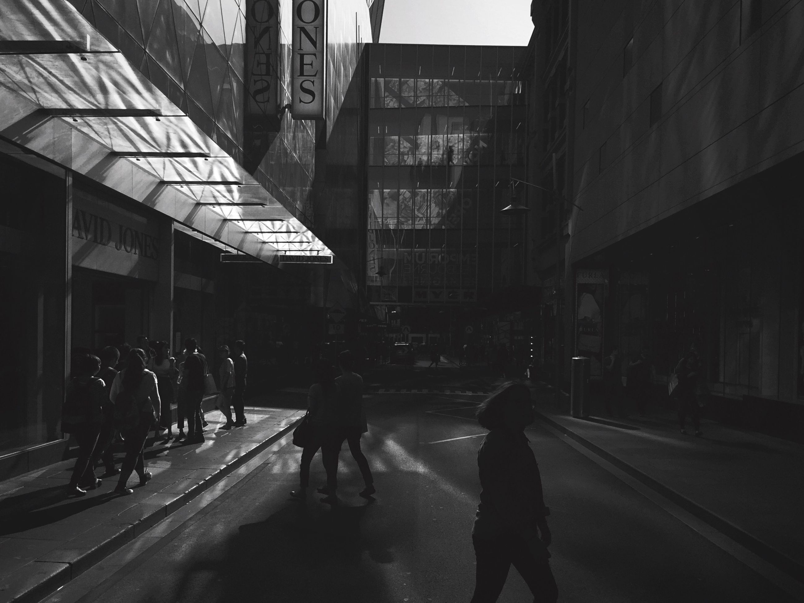 building exterior, architecture, built structure, city, street, walking, city life, transportation, men, the way forward, city street, road, person, lifestyles, car, building, road marking, on the move, full length