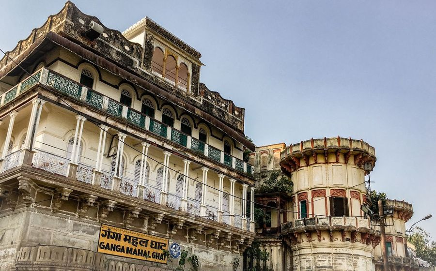 Varanasi, India Ganges, Indian Lifestyle And Culture, Bathing In The Ganges, Architecture Building Exterior Low Angle View Built Structure No People Outdoors Day Clear Sky Sky