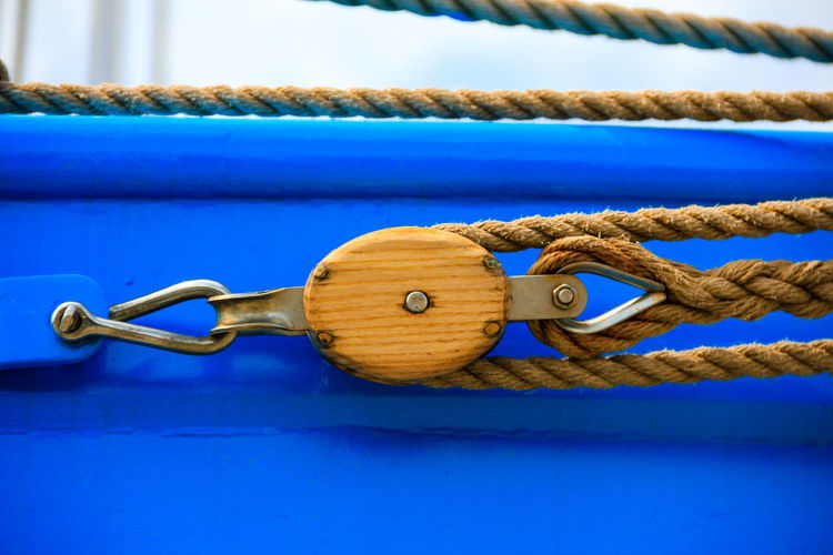 Close-up of rope with pulley on boat