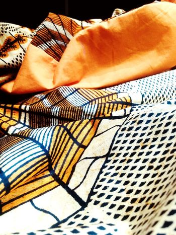 Wax fabric sewing Oranges Sewing Sew Africa Wax Textile Pattern No People Clothing Bed Close-up High Angle View Relaxation