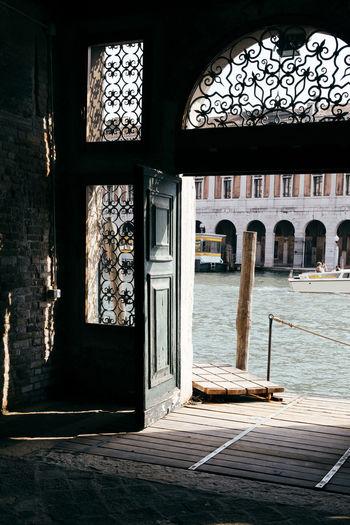 Grand canal by buildings seen through door