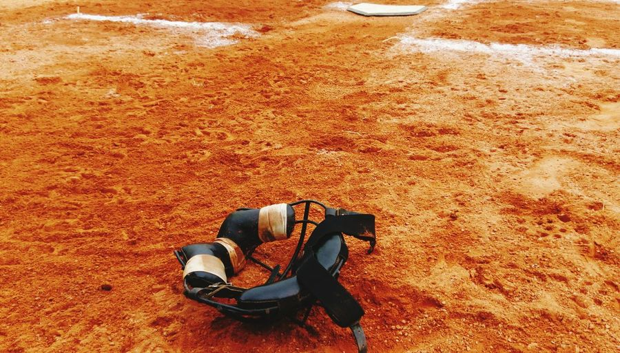 High angle view of baseball face mask on field