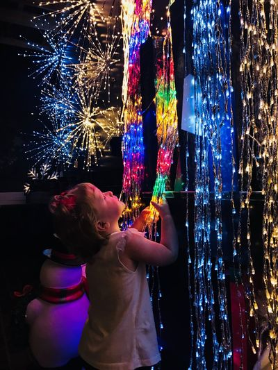 Childhood Real People Lifestyles Child One Person Illuminated Night Leisure Activity Water Nature Multi Colored Outdoors Motion Rear View Decoration #urbanana: The Urban Playground