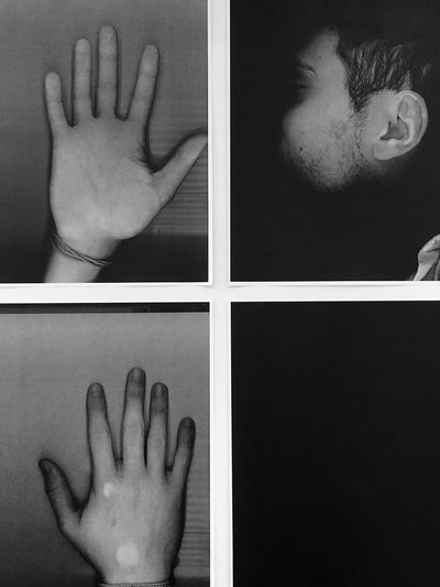 Close-up of human hand against gray background