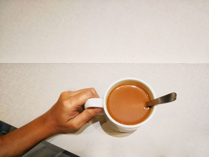 Coffee Hand Table Minimalist Space The Week Of Eyeem Holding Coffee Break Refreshment Food And Drink People One Person Human Body Part Close-up Adults Only Human Hand Indoors  Day Mocha Tea - Hot Drink Freshness Coffee - Drink Coffee Cup Lifestyles Adult