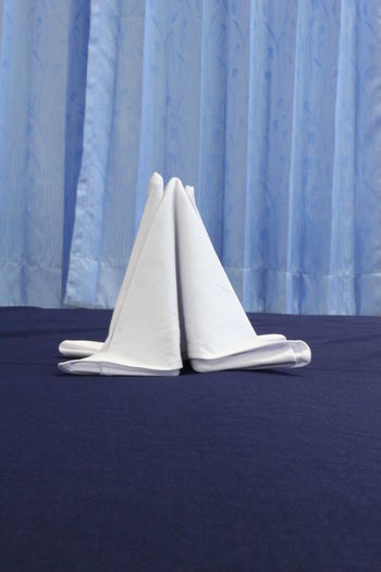 Napkin Folding NapkinFolding Napkins Absence Bed Blue Close-up Communication Curtain Day Hiding Hotel Service Indoors  Linen Napkin No People Paper Restaurant Security Sheet Simplicity Single Object Tent Textile Transportation