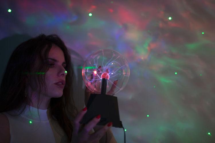 Young woman using smart phone at night