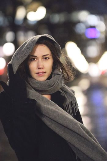 In the city Young Adult Looking At Camera One Person Real People Young Women Portrait Lifestyles Leisure Activity Outdoors Warm Clothing Front View Night Focus On Foreground Beautiful Woman Winter Smiling Happiness Women Standing Tree Bokeh Portrait Of A Woman