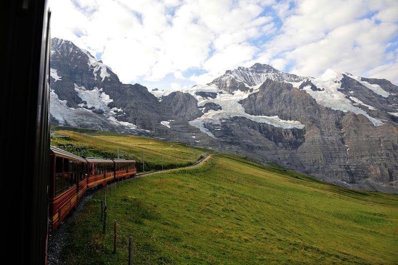 Train Towards Snowcapped Mountain
