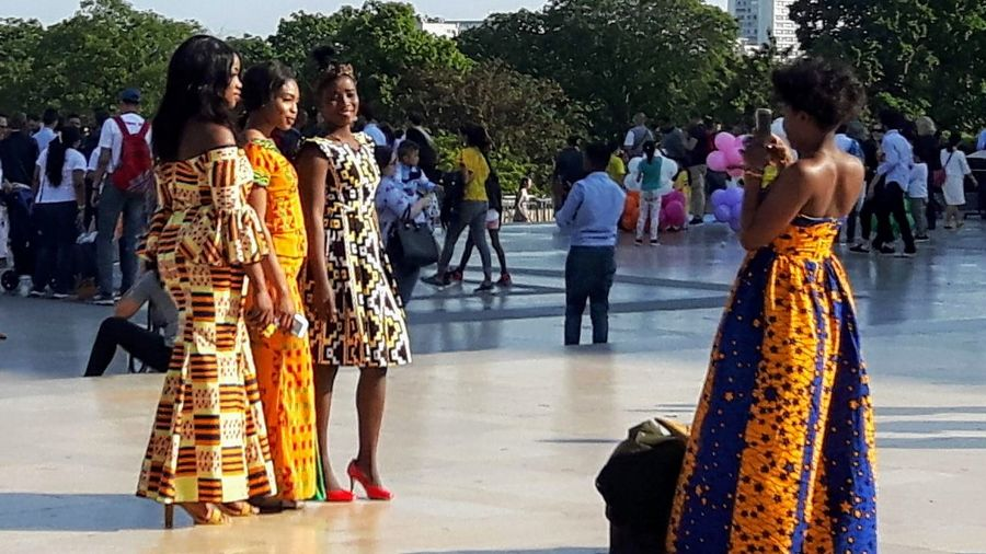 Tourism Shiny Day Sunlight Sunlight And Shadow Beautiful Women Colorful Clothes African Beauty African Clothes Young Adult Streetphotography City Women Traditional Clothing Arts Culture And Entertainment Tradition Posing Pretty The Art Of Street Photography