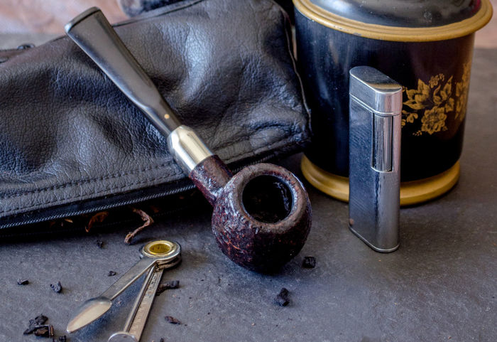 classic still life with a handsome wood pipe, leather pouch, lighter and humidor Antique Classic Humidor  Leather Retro Smoking Tobacco Addiction Collection Habit Lifestyles Lighter Nicotine Pipe Pipe Collector Pipe Pouch Pipe Tools Smoker Smoking Pipe Still Life Tobacco Product Tools Vintage Wood - Material
