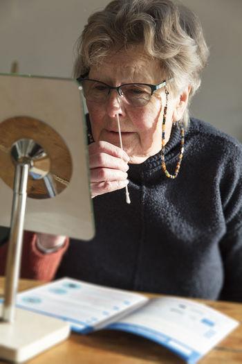 Senior woman doing medical test