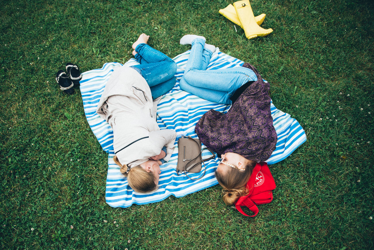 grass, high angle view, lying down, lying on back, togetherness