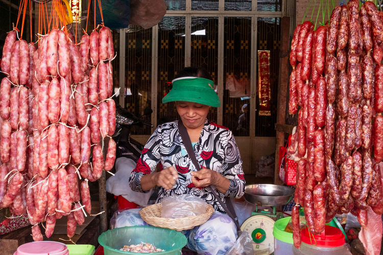 International Women's Day 2019 Food And Drink Food Retail  One Person Market Large Group Of Objects Abundance Business Adult Freshness Front View Small Business Holding Meat Occupation Market Stall Choice Working Real People Retail Display