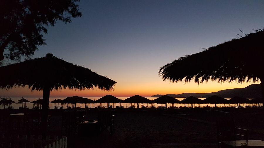 Greece, Crete Greece Paleochoribeach Sunset Sunset Silhouettes Hello World Holidays Enjoying Life Water Seaside Sea And Sky Beautiful Beach Day Beach Walk Beach Umbrella☂☂ Sunumbrella Palm Trees