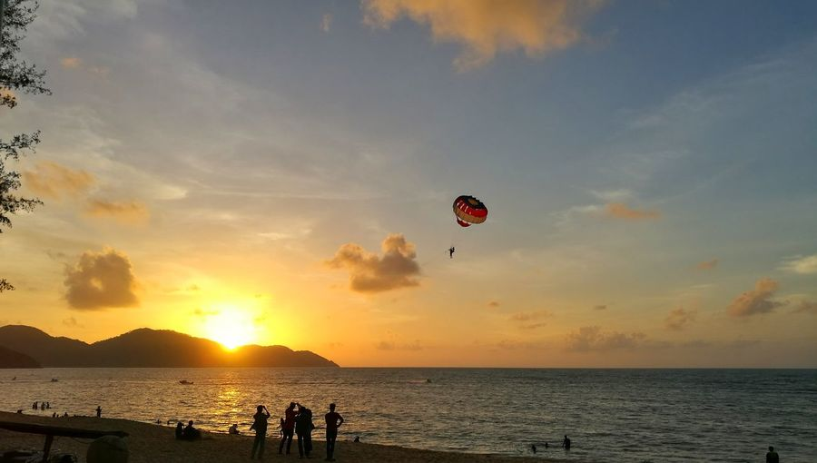 Sea Water Sunset Horizon Over Water Scenics Sky Cloud Tranquil Scene Tranquility Sun Beach Idyllic Vacations Calm Ocean Mid-air Beauty In Nature Enjoyment Flying Nature Street Photo Showcase October P9 Huawei People And Places