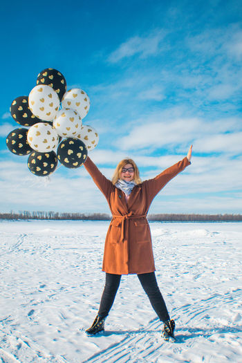 Sky One Person Cloud - Sky Full Length Nature Winter Young Adult Leisure Activity Young Women Happiness Land Snow Cold Temperature Emotion Front View Real People Standing Smiling Clothing Warm Clothing Limb Outdoors Arms Raised