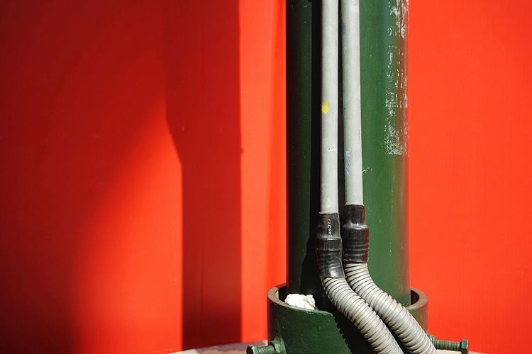 Pipes Building Site Red Orange Color Close-up Day Wall - Building Feature No People Green Color Built Structure Architecture Nature Sunlight Copy Space Wall