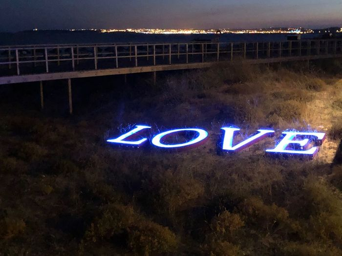 Love Night Communication Illuminated Text Western Script No People Nature Sign Information Architecture Capital Letter Outdoors Glowing Dark Neon Built Structure Dusk Direction Single Word City