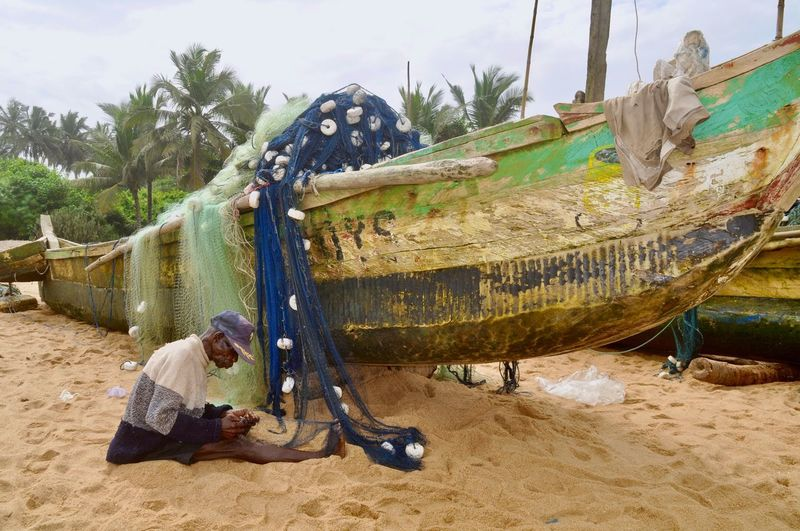 High angle view of fisherman working at beach