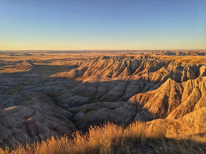 Badlands National Park EyeEm Selects Nature Beauty In Nature Landscape Physical Geography Geology Scenics Tranquil Scene Rock - Object Rock Formation Remote Travel Destinations Outdoors No People Mountain Arid Climate Tranquility Clear Sky Travel Desert Day