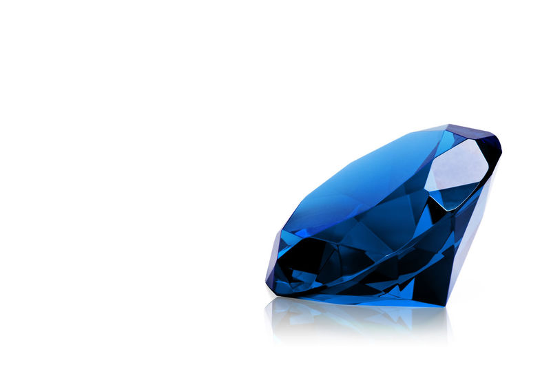 Blue diamond isolated on white background. Concept most precious beauty. Royal Stone Background Beauty Blue Bright Brilliant Carat Celebration Clear Commercial Crystal Diamond Engagement Expensive Facet Fashion Gem Gemstone  Gift Glass Industry Insurance Isolated Item Jewel Jewelery Jewelry Luxury Marriage  Millionaire Object Precious Reflection Rich Ring Shape Shine Shiny Sparkle Special Symbolic  Transparent Treasure Value Wealth White