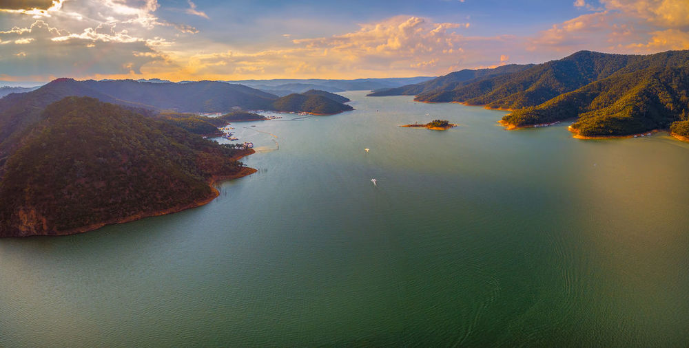 Aerial panorama of beautiful lake and mountains at sunset Australia Australian Australian Landscape Drone  Nature Scenic View Aerial Aerial View Beauty In Nature Dam Day Drone Photography Eildon Lake Lake Eildon Landscape Mountain Mountain Range Nature No People Outdoors Park Scenics Sky Tranquil Scene Tranquility Water Waterfront